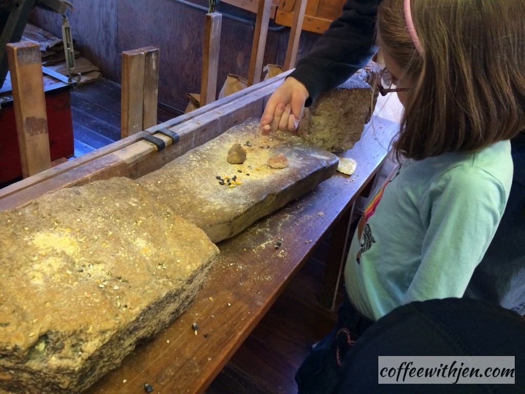 Grinding corn by hand.