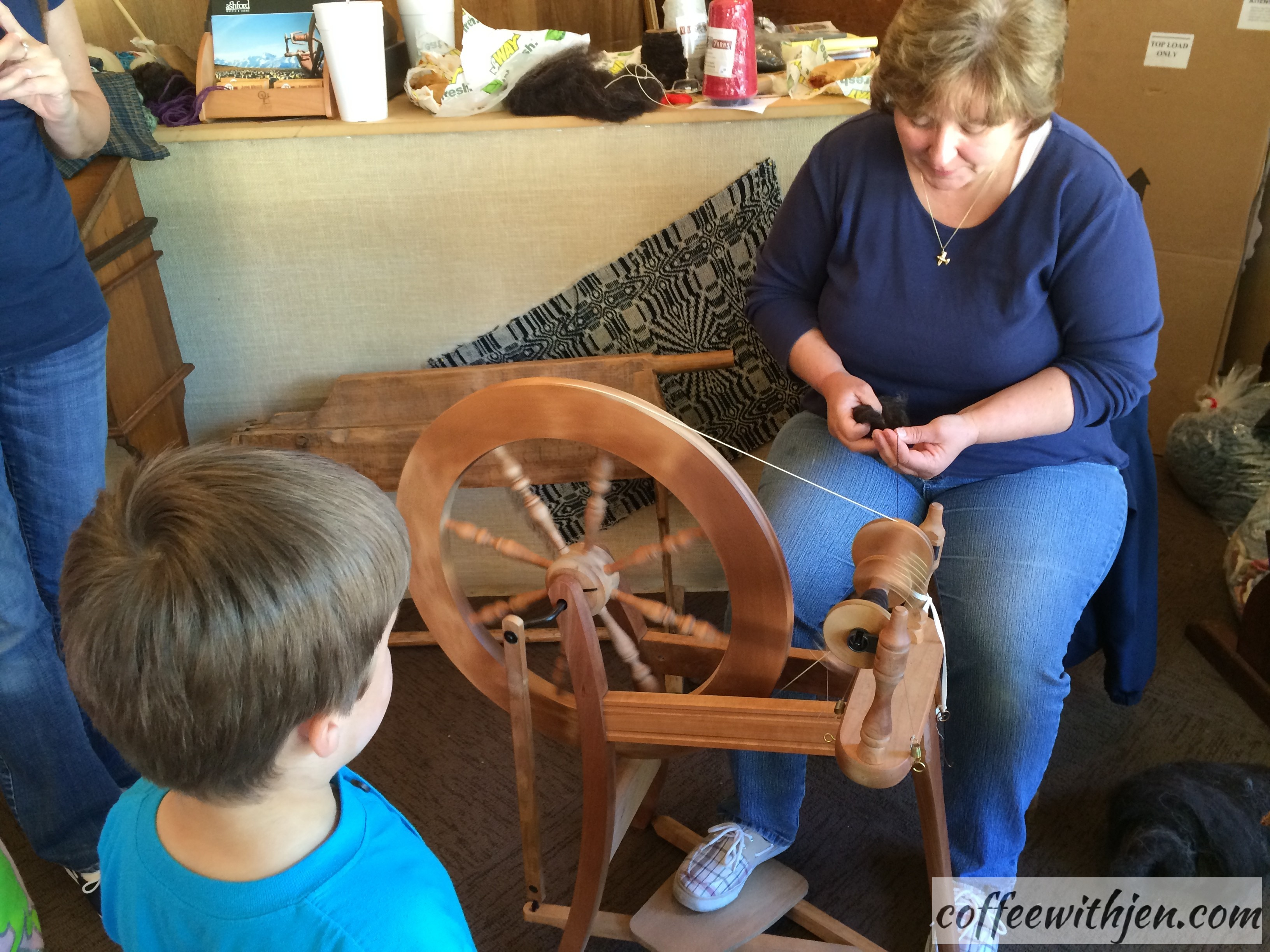 This was a live demonstration on how to spin wool into yarn.  See below for information on taking spinning and weaving classes.