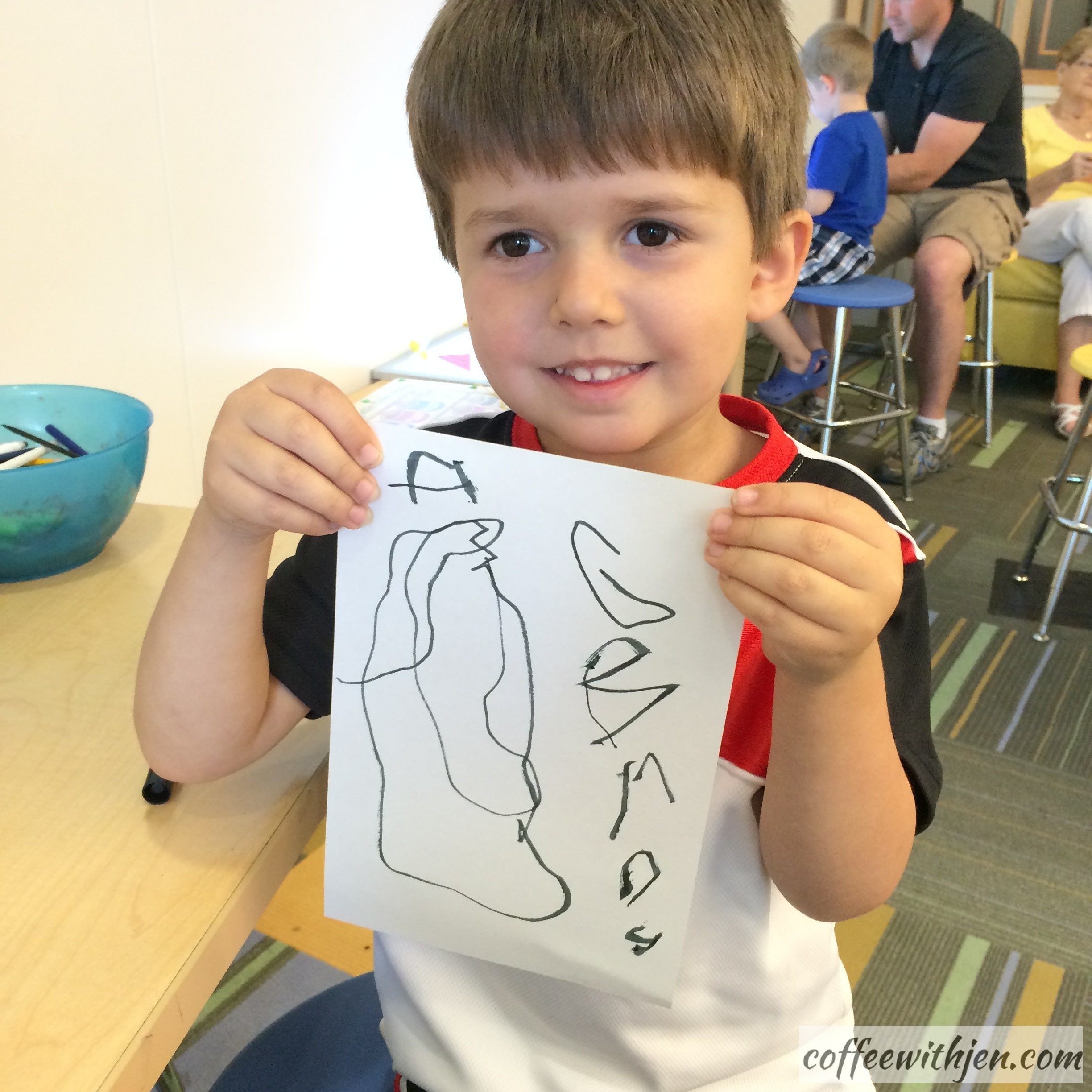 """He is only three-years-old, folks.  He said, """"I drew an Angry Birds world.""""  He wrote it by himself!  """"AG BRDS""""."""